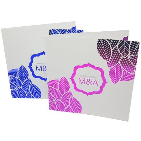 White invitations with blue and pink foil